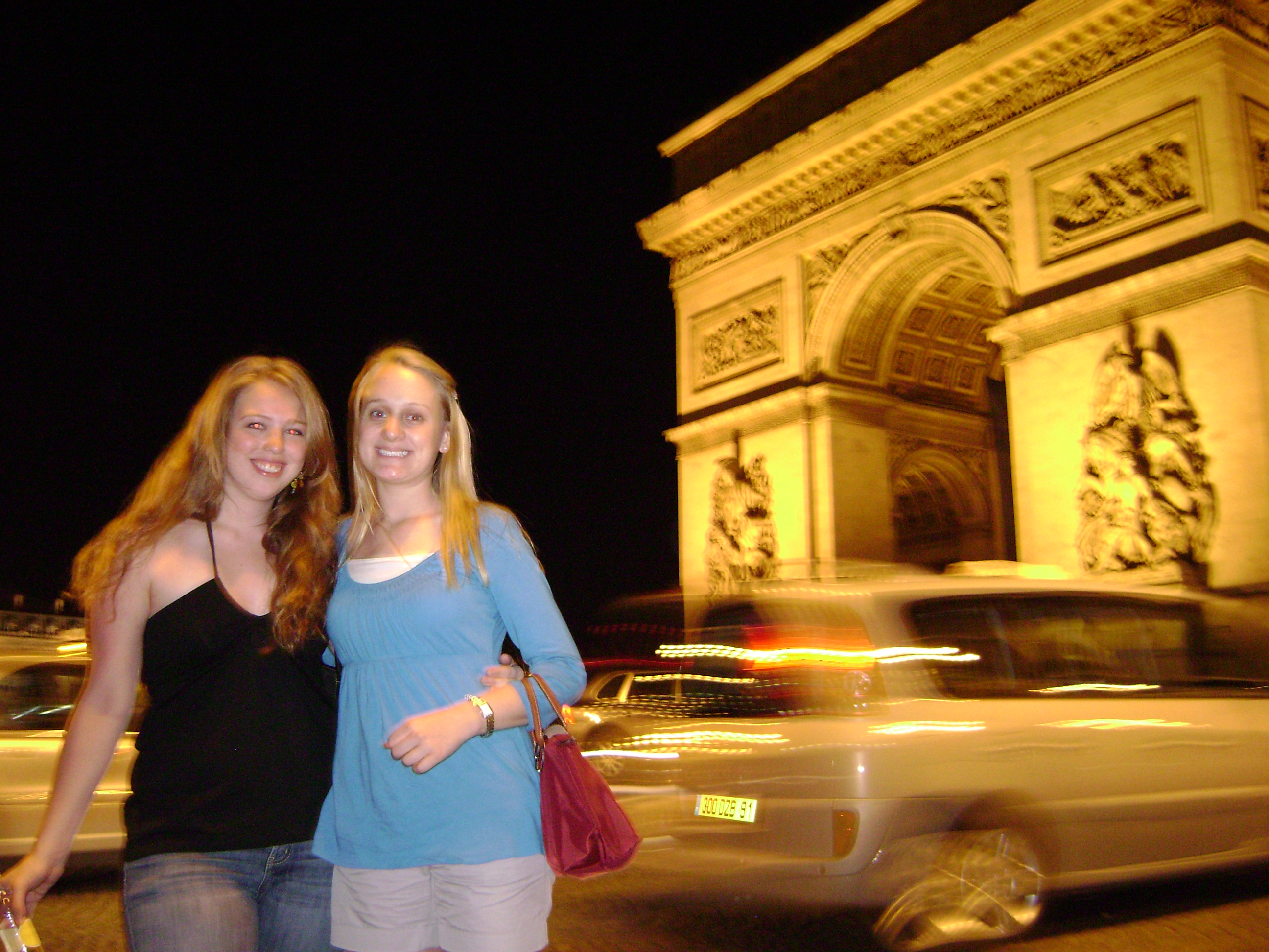 At the Arc de Triomphe at night